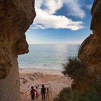 People accesing Nossa Senhora da Rocha beach, town of Porches, municipality of Lagoa, district of Faro, region of Algarve, Portugal