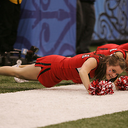 2 January 2009: Utah cheerleaders perform pushups after a score during a 31-17 win by the Utah Utes over the Alabama Crimson Tide in the 75th annual Allstate Sugar Bowl at the Louisiana Superdome in New Orleans, LA.