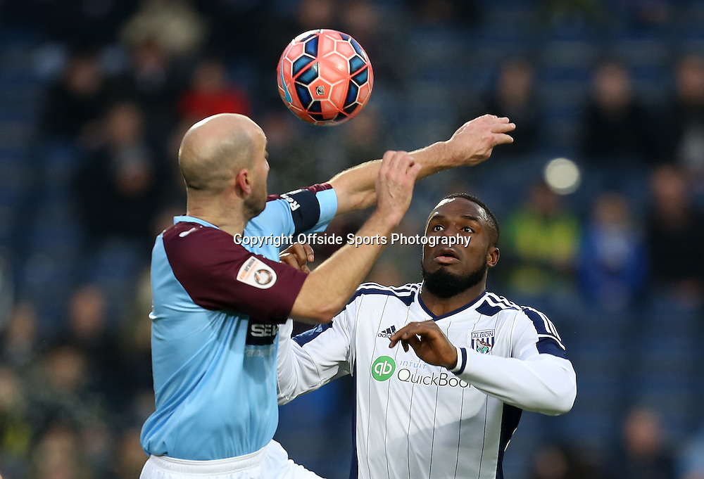 3rd January 2015 - FA Cup 3rd Round - West Bromwich Albion v Gateshead - Victor Anichebe of West Bromwich Albion is 2nd to a header loosing out to Ben Clark of Gateshead - Photo: Paul Roberts / Offside.