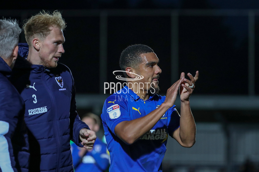 AFC Wimbledon striker Kweshi Appiah (9) clapping after final whistle and scoring a goal during the EFL Sky Bet League 1 match between AFC Wimbledon and Lincoln City at the Cherry Red Records Stadium, Kingston, England on 2 November 2019.