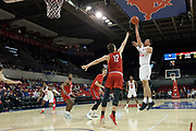 SMU Mustangs forward Ethan Chargois (25) shoots a jumper over Hartford Hawks forward Miroslav Stafl (12) while Moses Flowers (4), Hunter Marks (0), SMU Mustangs guard Tyson Jolly (0), and Isiaha Mike (15) wait for the potential rebound during an NCAA college basketball game, Wednesday, Nov. 27, 2019, in Dallas.SMU defeated Hartford 90-58. (Wayne Gooden/Image of Sport)