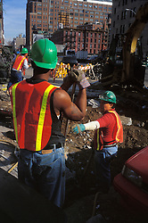 NYC utility repair construction site.  Safety vest helmets. Industrial workplace
