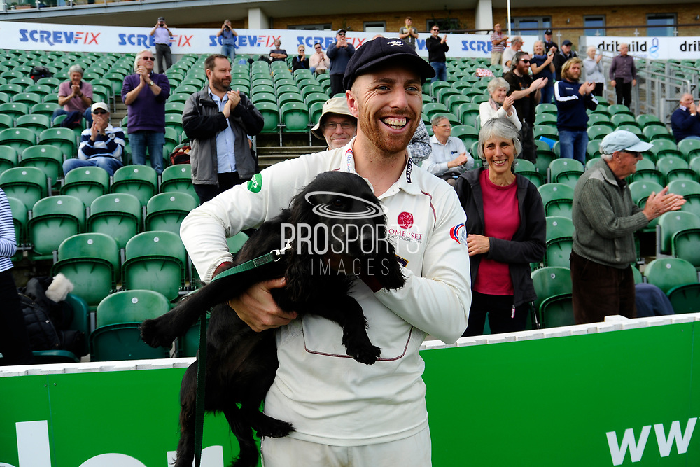 Jack Leach of Somerset, with his parents dog, on a lap of honour after beating Middlesex to secure survival in Division 1 of the Specsavers County Champ Div 1 match between Somerset County Cricket Club and Middlesex County Cricket Club at the Cooper Associates County Ground, Taunton, United Kingdom on 28 September 2017. Photo by Graham Hunt.