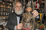 Mimmo Cuticchio in his workshop in Palermo with one of his puppet.Mimmo Cuticchio nel suo laboratorio a Palermo