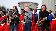 """Bruce Springsteen and Pete Seeger and Toa Seegrr (grandson of Pete Seeger) perform at the """"We are the One"""" Inaugural Concert at the Lincoln Memorial on January 18, 2009.  Photo by Dennis Brack"""