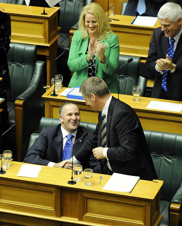 Prime Minister John Key is congratulated by his Finance Minister Bill English after speaking to the 2013 Budget, Debating Chamber, Wellington, New Zealand, Thursday, May 16, 2013. Credit:SNPA / Ross Setford