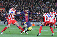 16.12.2012. Barcelona, Spain. La Liga day 16. Picture show Leo Messi and Godin in action during game FC Bracelona against Atletico Madrid at Camp Nou