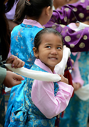 © Licensed to London News Pictures. 14/05/2012. City of London, UK A young girl waits for the arrival. The Dalai Lama arrives at St Paul's Cathedral today 14 may 2012 to be presented with the £1.1m Templeton annual prize in his first visit to the Cathedral. The award is for a living person who has 'made an exceptional contribution to affirming the spiritual dimension of life'.. Photo credit : Stephen Simpson/LNP