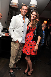 Olympic rower PETER REED and SALLY HOGBIN at a pool party to celebrate the UK launch of the Omega Ladymatic Collection held at the Haymarket Hotel, Haymarket, London on 16th June 2011.