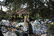 "KHAO LAK,SOUTHERN THAILAND,AUGUST 2012: Many Moken have had to find work away from the sea, like Ba Chee, an elder woman who scavenges for recyclables around the beaches and resorts of the Khao Lak area in southern Thailand.<br /> The Moken are a nomadic sea people who live in and around southern Thailand, traditionally feeding of the fruits of the sea for eight months a year. But the 2004 Indian Ocean tsunami destroyed many livelihoods, and the Moken were forced onto the land.<br /> Brought to the world's attention by the natural disaster, the seafaring tribe is struggling to reconcile tradition and modernity, leaving behind their ""sea gypsy"" life for a modern existence"