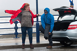 © Licensed to London News Pictures. 02/11/2019. Porthcawl, Bridgend, Wales, UK. People struggle against the elements as the wind increases to storm force 10 and rain continues relentlessly at the seaside resort of Porthcawl in Bridgend, UK. Photo credit: Graham M. Lawrence/LNP