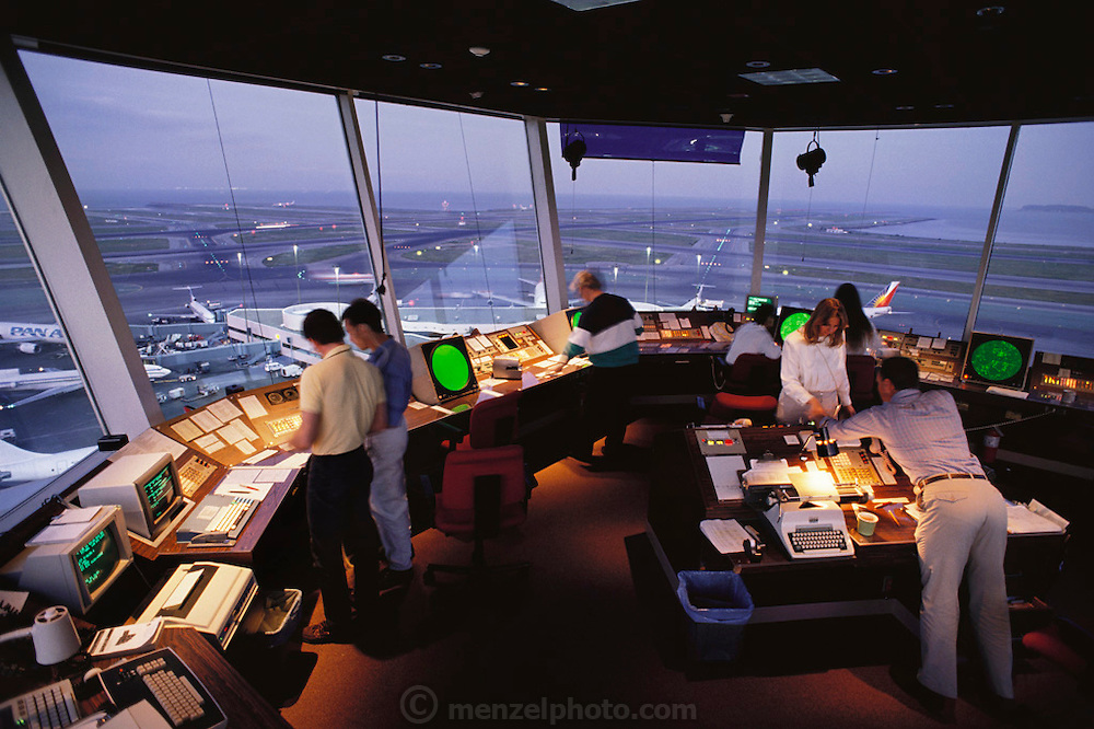 Interior view of the Air Traffic Control Tower at San Francisco International Airport. The green radar displays show aircraft flying within 50 nautical miles of the airport, captured by the Primary Surveillance Radar (PSR). Controllers here deal only with aircraft within San Francisco's Terminal Maneuvering Area (TMA): aircraft flying over the area and those up to 250 nautical miles away are dealt with by regional controllers elsewhere in the tower.