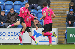 Jon Taylor of Peterborough United (left) jumps for joy after scoring the opening goal of the game - Mandatory by-line: Joe Dent/JMP - 16/04/2016 - FOOTBALL - Weston Homes Community Stadium - Colchester, England - Colchester United v Peterborough United - Sky Bet League One