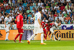 Miso Brecko of Slovenia and Raheem Sterling of England during the EURO 2016 Qualifier Group E match between Slovenia and England at SRC Stozice on June 14, 2015 in Ljubljana, Slovenia. Photo by Grega Valancic