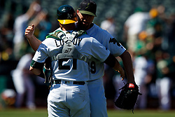 OAKLAND, CA - MAY 27:  Blake Treinen #39 of the Oakland Athletics celebrates with Jonathan Lucroy #21 after the game against the Arizona Diamondbacks at the Oakland Coliseum on May 27, 2018 in Oakland, California. The Oakland Athletics defeated the Arizona Diamondbacks 2-1. (Photo by Jason O. Watson/Getty Images) *** Local Caption *** Blake Treinen; Jonathan Lucroy