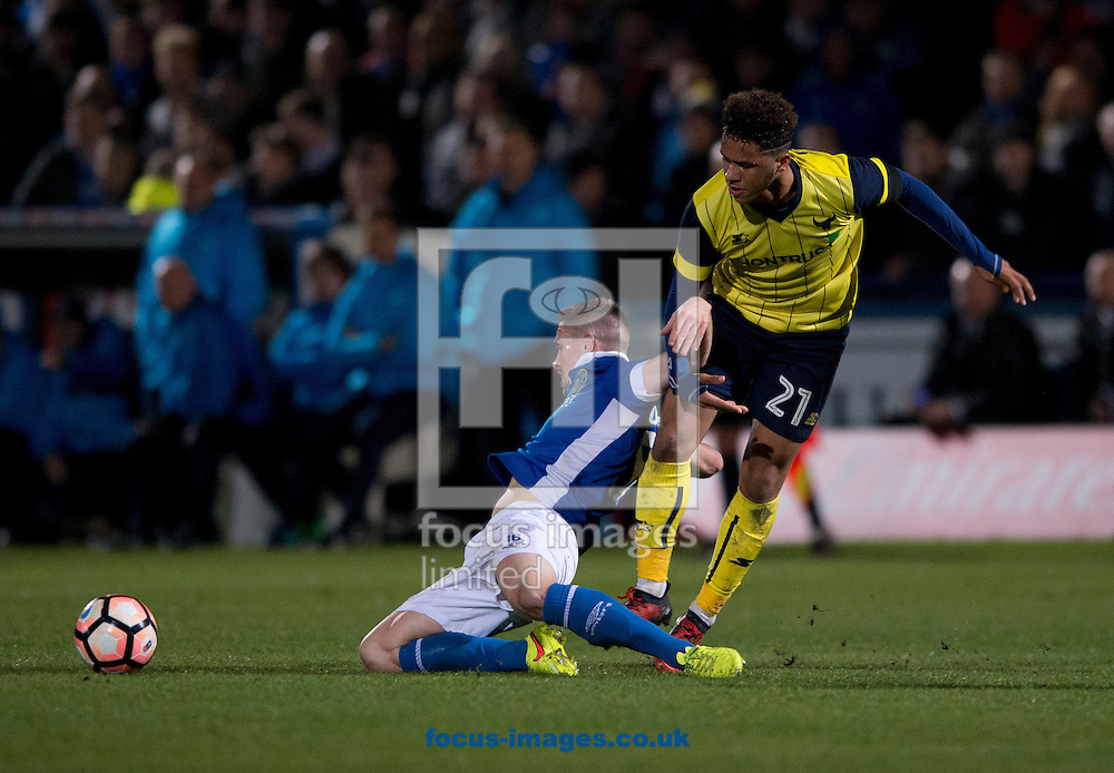 Mitch Hancox of Macclesfield Town (left) gets to the ball ahead of Tyler Roberts of Oxford United during the FA Cup match at Moss Rose, Macclesfield<br /> Picture by Russell Hart/Focus Images Ltd 07791 688 420<br /> 02/12/2016