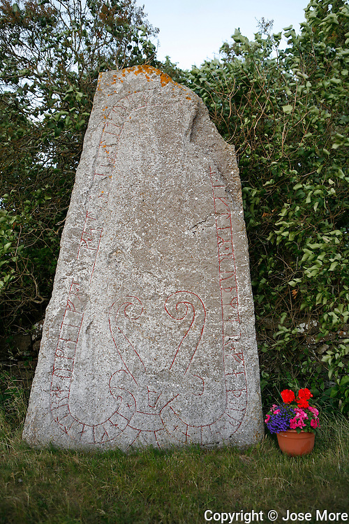 Runestone near Seby on the island Oland in Sweden. A runestone is a raised stone with a runic inscription,dating from the late Viking Age. Runestones are memorials to the dead, usually brightly colored when erected. <br /> Photography by Jose More