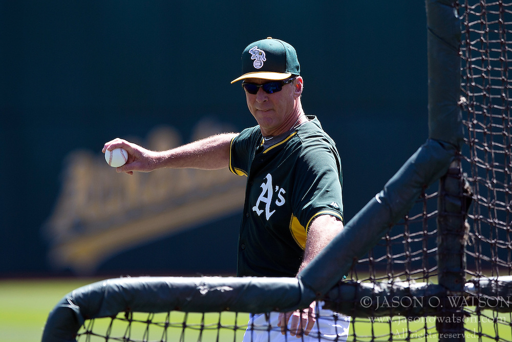 OAKLAND, CA - JUNE 21:  Bob Melvin #6 of the Oakland Athletics pitches during batting practice before the game against the Los Angeles Angels of Anaheim at O.co Coliseum on June 21, 2015 in Oakland, California. The Oakland Athletics defeated the Los Angeles Angels of Anaheim 3-2. (Photo by Jason O. Watson/Getty Images) *** Local Caption *** Bob Melvin