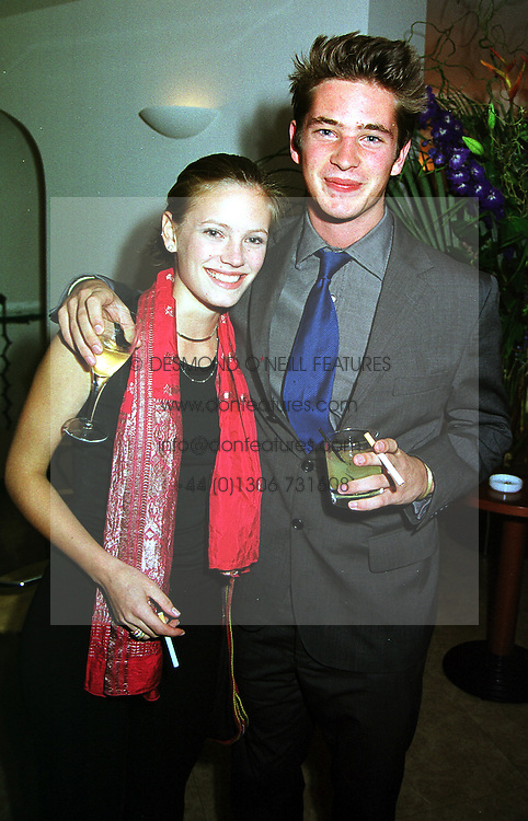 MISS LULU COLDREY and the HON.JAMES TOLLEMACHE son of Lord Tollemache, at a party in London on 14th September 1999.MWI 26