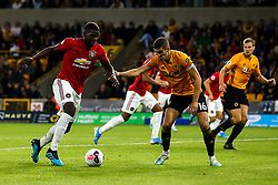 Paul Pogba of Manchester United takes on Conor Coady of Wolverhampton Wanderers - Mandatory by-line: Robbie Stephenson/JMP - 19/08/2019 - FOOTBALL - Molineux - Wolverhampton, England - Wolverhampton Wanderers v Manchester United - Premier League