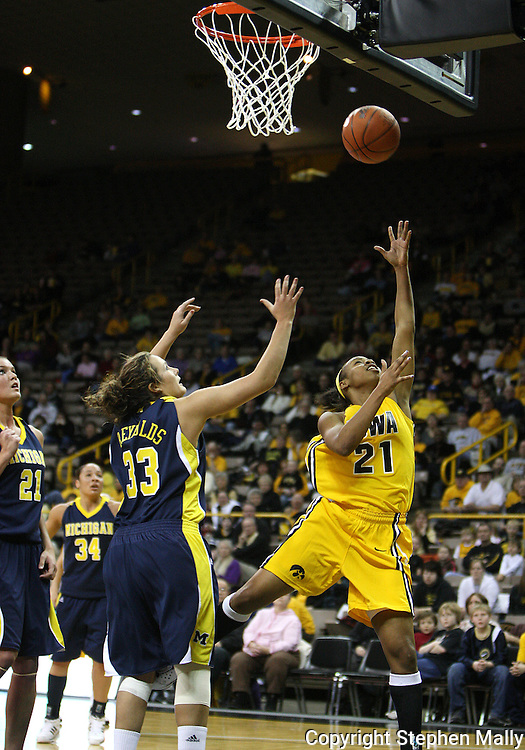 26 JANUARY 2009: Iowa guard Kachine Alexander (21) puts up a shot while being guarded by Michigan guard/forward Carmen Reynolds (33) during the first half of an NCAA women's college basketball game Monday, Jan. 26, 2009, at Carver-Hawkeye Arena in Iowa City, Iowa. Iowa defeated Michigan 77-69.