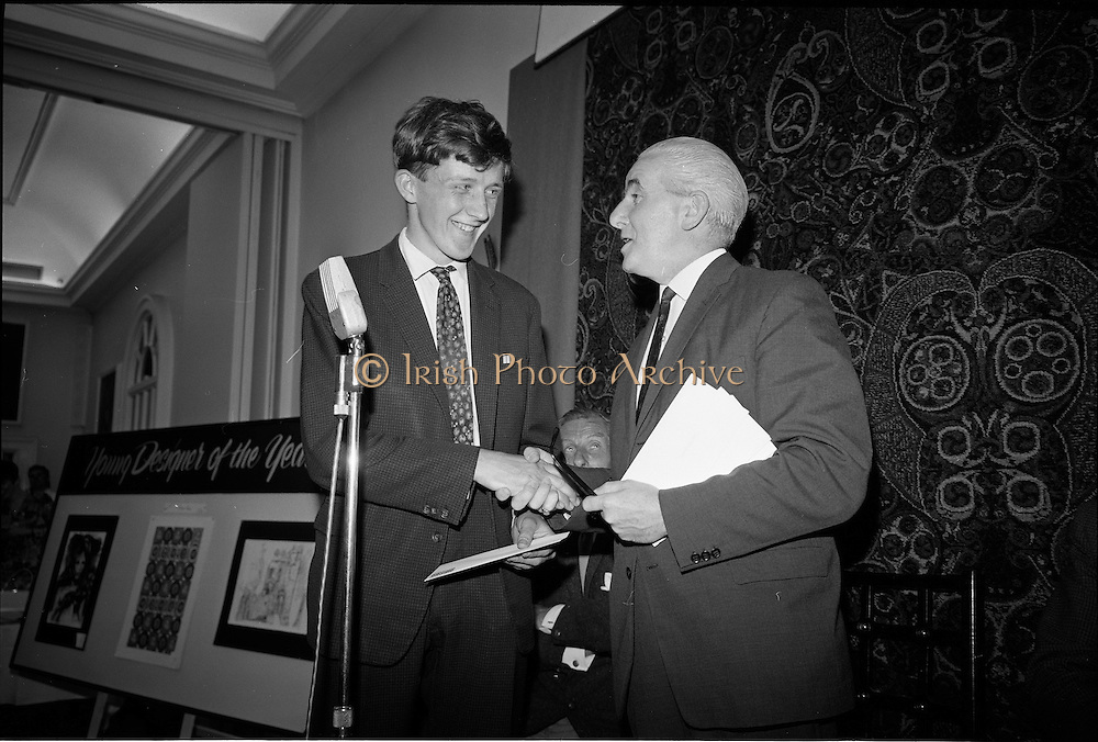 "28/06/1967<br /> 06/28/1967<br /> 28 June 1967<br /> Presentation of prizes at Navan Carpets ""Young Designer of the Year"" reception in the Royal Hibernian Hotel, Dublin. Image shows Mr. James White, Director National Gallery of Ireland presenting a cash prize to one of the winners Michael Ó Éigeartaigh, Turners Cross, Cork."