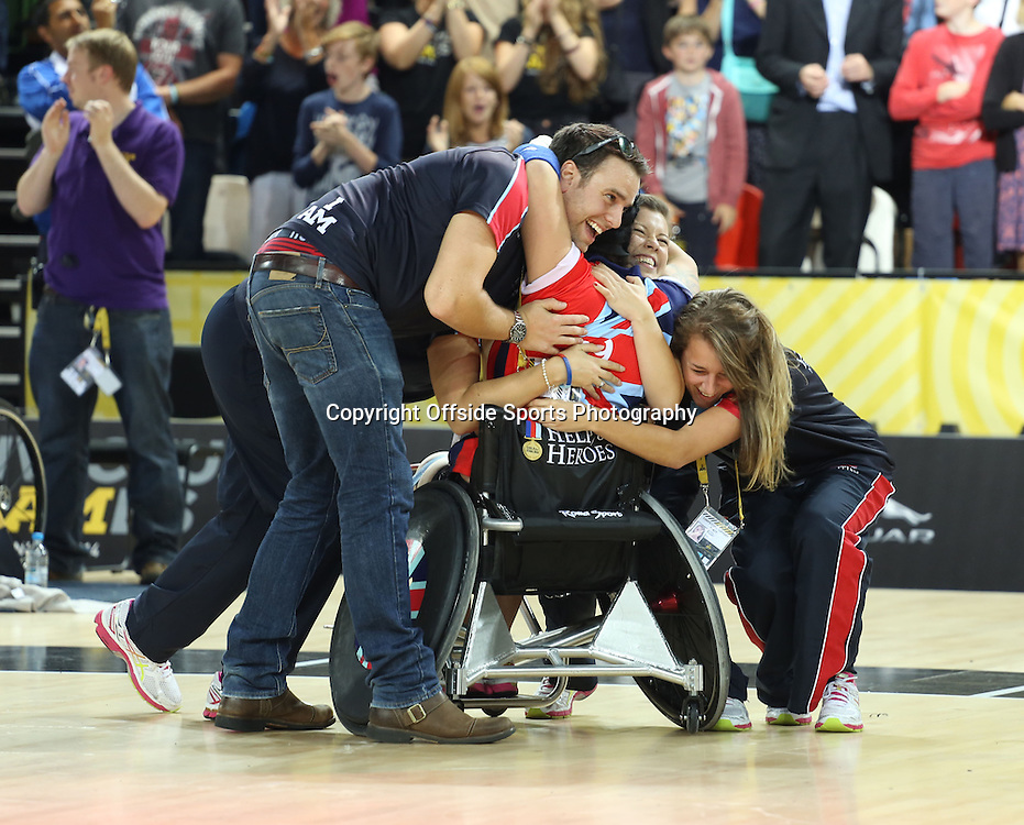 12 September 2014 - Invictus Games Day 2 - The GB squad celebrate winning the gold medal in the wheelchair rugby.<br /> <br /> Photo: Ryan Smyth/Offside