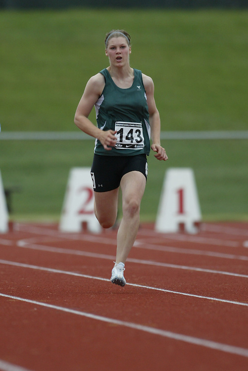 (Charlottetown, Prince Edward Island -- 20090717) Kelsey Bohachewski of Bjorkdale Bandits Track competes in the 100m at the 2009 Canadian Junior Track & Field Championships at UPEI Alumni Canada Games Place on the campus of the University of Prince Edward Island, July 17-19, 2009.  Copyright Sean Burges / Mundo Sport Images , 2009...Mundo Sport Images has been contracted by Athletics Canada to provide images to the media.