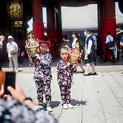 TOKYO, JAPAN - MAY 14: Young participants carry a small mikoshi (portable shrine) to take photo in front of Senso-ji Temple in Tokyo on May 14, 2016. The huge parade draws over two million people flocked to Tokyo's Asakusa district during the annual three-day-long festival, this marked the second day of Sanja Matsuri which is held on the third weekend of every May at Asakusa Shrine, Tokyo, Japan.<br /> <br /> Photo: Richard Atrero de Guzman