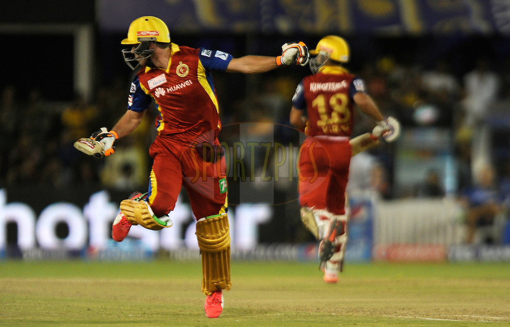 AB De Villiers of Royal Challengers Bangalore avoids a ball as he tries to complete a run during match 22 of the Pepsi IPL 2015 (Indian Premier League) between The Rajasthan Royals and The Royal Challengers Bangalore held at the Sardar Patel Stadium in Ahmedabad , India on the 24th April 2015.<br /> <br /> Photo by:  Pal Pillai / SPORTZPICS / IPL