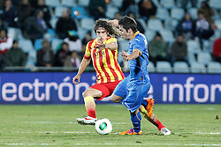 16.01.2014, Coliseum Alfonso Perez, Getafe, ESP, Copa del Rey, FC Getafe vs FC Barcelona, Achtelfinale, Rueckspiel, im Bild Getafe´s Sarabia (R) and Barcelona´s Puyol // Getafe´s Sarabia (R) and Barcelona´s Puyol during the last sixteen 2nd leg match of Spanish Copa del Rey between Getafe CF and Barcelona FC at the Coliseum Alfonso Perez in Getafe, Spain on 2014/01/16. EXPA Pictures © 2014, PhotoCredit: EXPA/ Alterphotos/ Victor Blanco<br /> <br /> *****ATTENTION - OUT of ESP, SUI*****