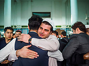 15 JUNE 2018 - SEOUL, SOUTH KOREA: Men greet each other after Eid al Fitr services at Seoul Central Mosque on Eid al Fitr, the Muslim Holy Day that marks the end of the Holy Month of Ramadan. There are fewer than 100,000 Korean Muslims, but there is a large community of Muslim immigrants in South Korea, most in Seoul. Thousands of people attend Eid services at Seoul Central Mosque, the largest mosque in South Korea.    PHOTO BY JACK KURTZ