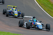 Sebastian Alvarez (MEX) of Double R Racing exits Butchers, closely followed by Zane Maloney (BAR) of Carlin Motorsport during Round 23 of the FIA Formula 4 British Championship at Knockhill Racing Circuit, Dunfermline, Scotland on 15 September 2019.