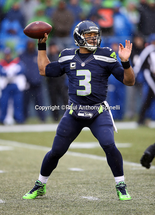 Seattle Seahawks quarterback Russell Wilson (3) throws a pass during the 2015 NFL week 16 regular season football game against the St. Louis Rams on Sunday, Dec. 27, 2015 in Seattle. The Rams won the game 23-17. (©Paul Anthony Spinelli)