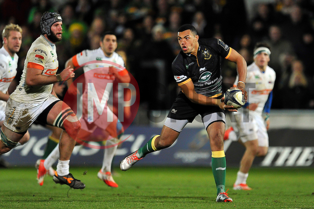 Luther Burrell of Northampton Saints looks to pass the ball - Photo mandatory by-line: Patrick Khachfe/JMP - Mobile: 07966 386802 13/12/2014 - SPORT - RUGBY UNION - Northampton - Franklin's Gardens - Northampton Saints v Treviso - European Rugby Champions Cup