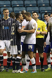 Millwall's DJ Cambell and Sheffield Wednesday's Giles Coke come to blows - Photo mandatory by-line: Robin White/JMP - Tel: Mobile: 07966 386802 28/01/2014 - SPORT - FOOTBALL - The Den - Millwall - Millwall v Sheffield Wednesday - Sky Bet Championship