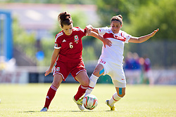 HAVERFORDWEST, WALES - Saturday, June 14, 2014: Wales' Angharad James in action against Turkey's Arzu Karabulut during the FIFA Women's World Cup Canada 2015 Qualifying Group 6 match at the Bridge Meadow Stadium. (Pic by David Rawcliffe/Propaganda)