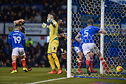 Portsmouth Defender, Matt Clarke (5) scores a goal and turns to celebrate 1-0 during the EFL Sky Bet League 1 match between Portsmouth and Bury at Fratton Park, Portsmouth, England on 16 December 2017. Photo by Adam Rivers.