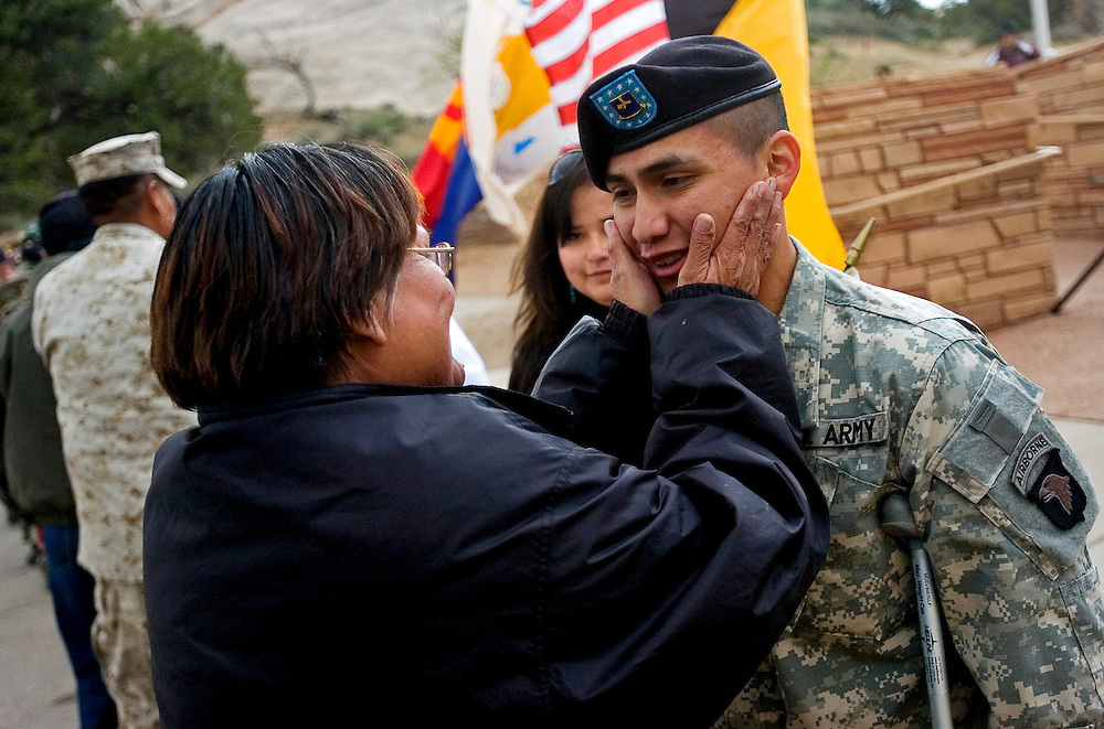 051508       Brian Leddy.Nineteen-year-old Jason Whitehorse gets a squeeze on the cheek from Linda Montoya of Fort Defiance during the Navajo/Hopi Honor Ride event on Thursday. Whitehorse, who just returned from Iraq after being injured in an explosion, received two Purple Heart medals for his work there.