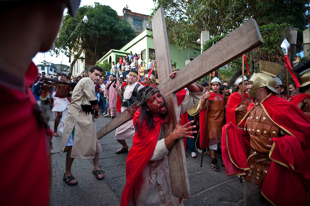 """Faithful perform during the """"Via Crucis"""" (Way of the Cross) procession, which commemorates Jesus Christ's Crucifixion during Holy Week in the barrio El Nazareno in Petare, Caracas. Friday, April 10, 2009. Holy Week commemorates the last week of the earthly life of Jesus Christ culminating in his crucifixion on Good Friday and his resurrection on Easter Sunday. (Photo/Ivan Gonzalez)"""
