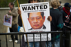 © London News Pictures. 31/10/2012. London, UK.  A man holding up a banner during a protest outside Downing Street, London against alleged human rights abuses committed by Indonesia's government against West Papuan tribespeople. The President of Indonesia, Susilo Bambang Yudhoyono, is currently on a state visit to the UK.  Photo credit: Ben Cawthra/LNP