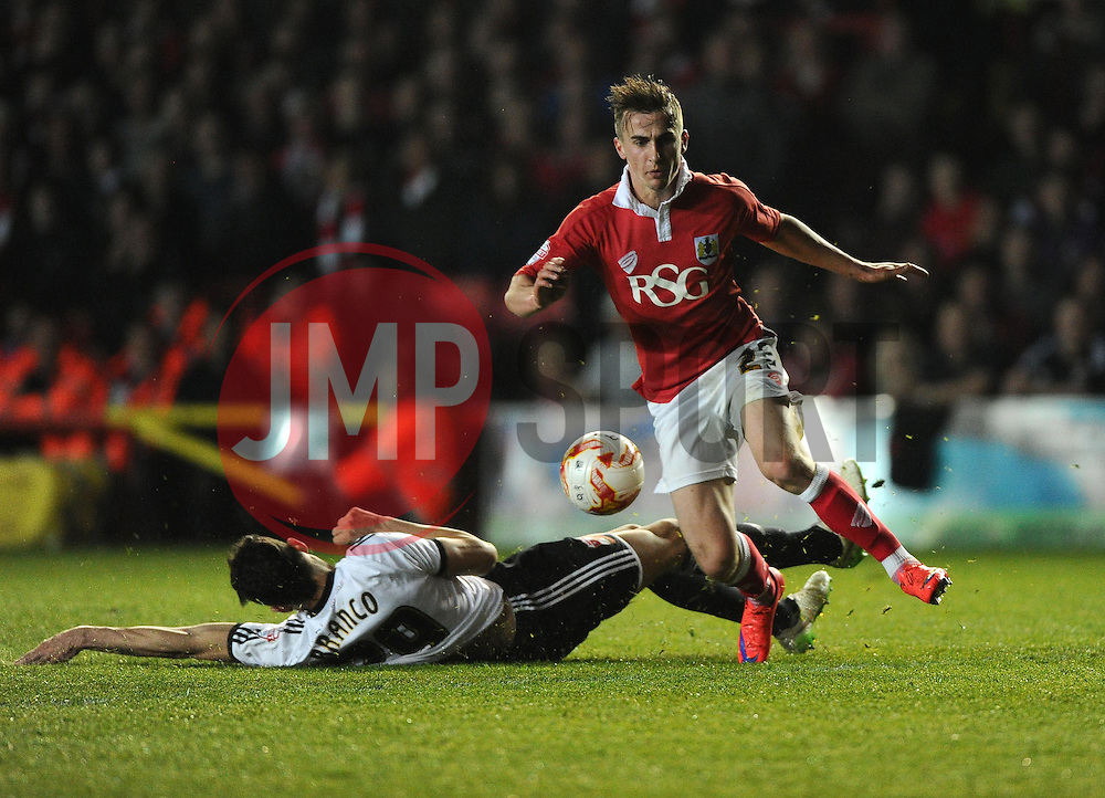 Swindon Town's Raphael Rossi Branco tackles Bristol City's Joe Bryan  - Photo mandatory by-line: Joe Meredith/JMP - Mobile: 07966 386802 - 07/04/2015 - SPORT - Football - Bristol - Ashton Gate - Bristol City v Swindon Town - Sky Bet League One