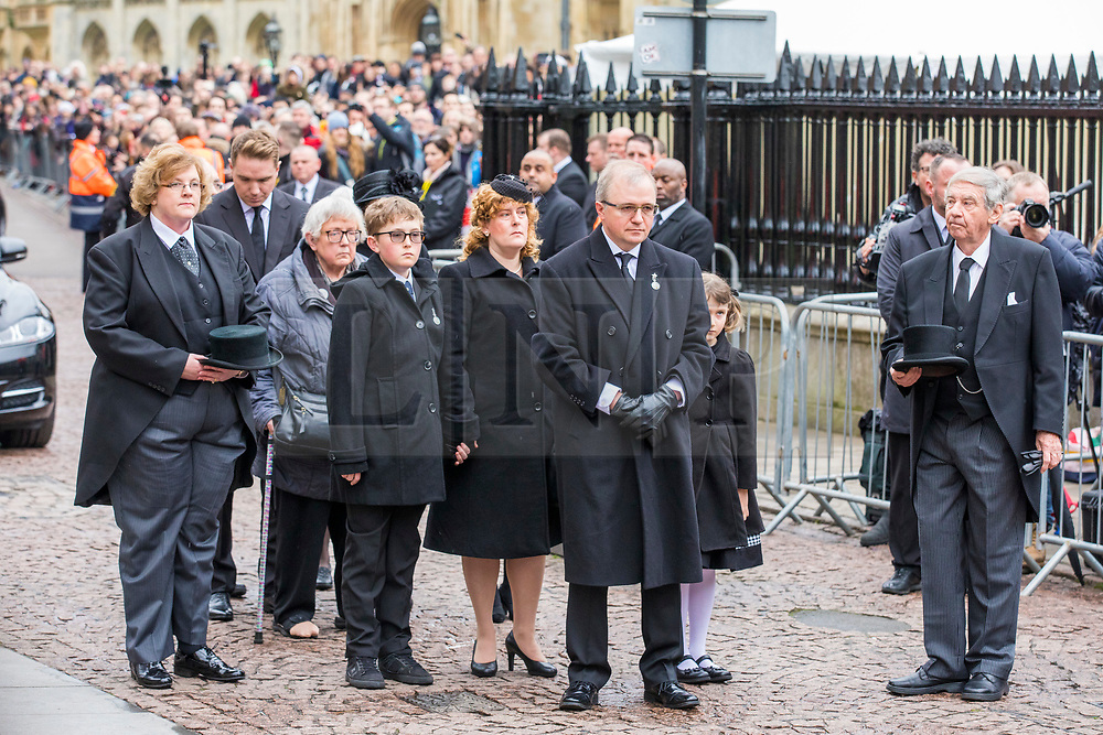 © Licensed to London News Pictures. 31/03/2018. Cambridge, UK. Family members at the funeral of Stephen Hawking at Church of St Mary the Great in Cambridge, Cambridgeshire. Professor Hawking, who was famous for ground-breaking work on singularities and black hole mechanics, suffered from motor neurone disease from the age of 21. He died at his Cambridge home in the morning of 14 March 2018, at the age of 76. Photo credit: Rob Pinney/LNP