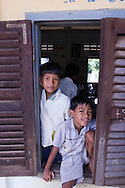 Young school children at Kompong Phlukk floating village, Tonle Sap, Cambodia