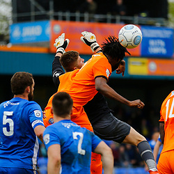 Braintrees Mark Okoye and Gloucesters Andy Hannah meet mid air during the Vanorama National League South match between Braintree Town FC and Gloucester City FC at the IronmongeryDirect Stadium, Essex on 28 April 2018. Photo by Matt Bristow.