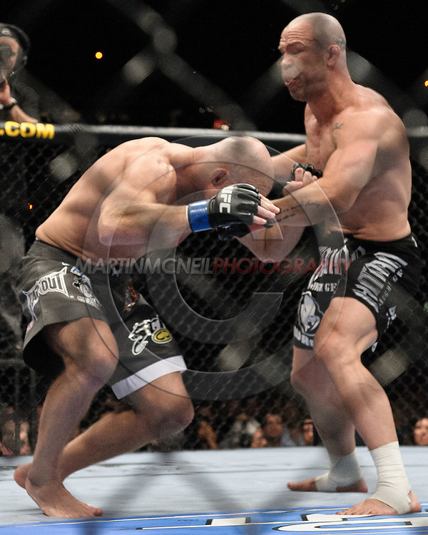 "LAS VEGAS, NEVADA, MAY 24, 2008: Keith Jardine (left) buckels from a punch by Wanderlei Silva during ""UFC 84: Ill Will"" inside the MGM Grand Garden Arena in Las Vegas"
