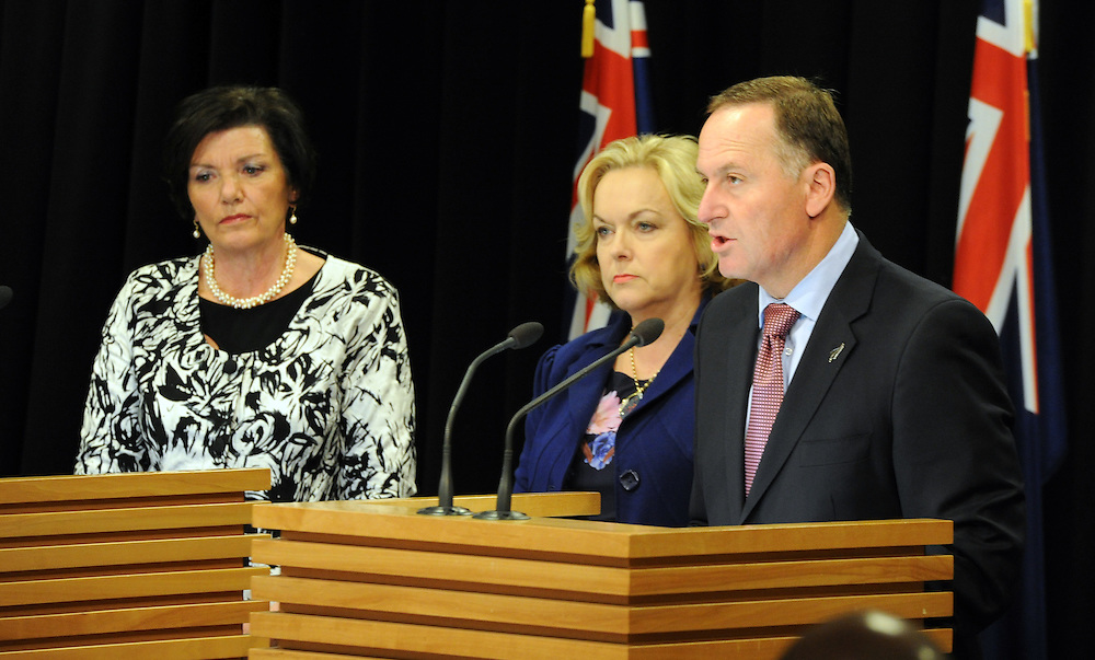 Prime Minister John Key, right with Minister of Police Anne Tolley and Minister of Justice Judith Collins  at the announcement on addressing family violence at Parliament, Wellington, New Zealand, Wednesday, July 02, 2014. Credit:SNPA / Ross Setford