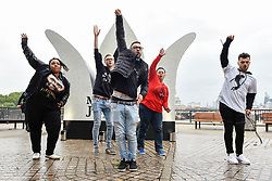 "© Licensed to London News Pictures. 29/08/2018. LONDON, UK.  Michael Jackson fans dance to ""Beat It"" next to a 13 foot high jewelled crown which has been installed on the South Bank to mark Michael Jackson's 60th birthday.  Photo credit: Stephen Chung/LNP"