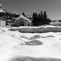 A mountain cemetery covered with snow in the town of Cortina