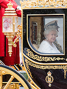 © Licensed to London News Pictures. 18/05/2016. London, UK Her Majesty QUEEN ELIZABETH II travels to Parliament today, 18th May 2016, to attend the State Opening of Parliament. The monarch formally opens Parliament and delivers the Queen's Speech, written by the government, which sets out Parliament's agenda for the coming year. Photo credit : Stephen Simpson/LNP